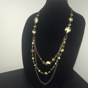 NWT. Long multi-chained beaded necklace.